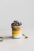 Mango mousse dessert with yogurt and blackberries