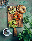 Bagels with various spreads (mushroom mayonnaise, guacamole, bean and tomato)