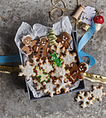 Butter biscuits and gingerbread men in a box with Christmas decorations