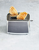 Waffles being defrosted in a toaster