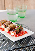 Courgette and aubergine rolls with ham and mozzarella