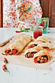 Gratinated tortillas with ham, tomatoes and mozzarella