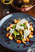 Delicious salad with fresh vegetables and leaves with shrimps and cheese