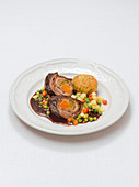 Beef roulade with dumplings and vegetables
