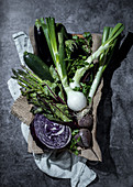 Still life with green and purple vegetables