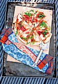 Pizza 'Parma' with rocket and mozzarella