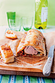 Pork fillet with vegetables and mozzarella in puff pastry