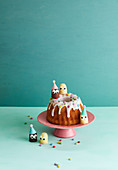 A birthday Bundt cake with chocolate marshmallow people