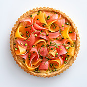 Melon crostata with lime cream and pistachios