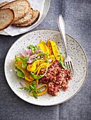 Tartar with pumpkin salad