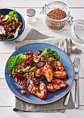 Spicy chicken wings with warm autumn salad