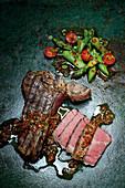 Porterhouse steak with chimichurri and green asparagus salad