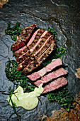 Grilled rib-eye steak with seaweed salad
