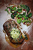 Grilled rump steak with herb butter and wild herb salad