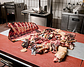 Sections and cuttings of aged meat in a butcher's shop