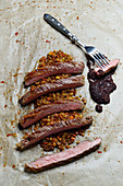 Flank steak with purple mustard and alba lentil ragout