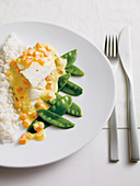 Pangasius fillet in coconut sauce with mange tout