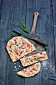 Classic tarte flambée with bacon and chives