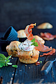 Herb and tomato cupcakes with serrano ham topping