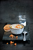 Vegan coconut curry soup with coconut brittle