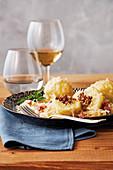 Big dumplings on bacon and sauerkraut