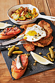 Holstein escalope with fried potatoes, salmon and fried egg