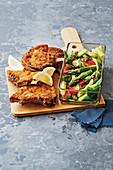 Baked pork chop with lukewarm asparagus salad