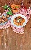 Minced meat and mozzarella balls with tomato risotto