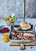 Pulled pork burger with red cabbage salad and mango chutney