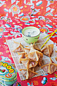 Strawberry wontons with mozzarella and lavender sauce