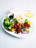 Spiced lamb cutlets with tomato and herb salad