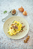 Scrambled egg with white alba truffles from Italy