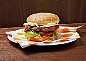 A hamburger with Cheddar cheese