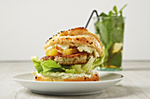 A fish burger with a pineapple and chilli chutney