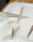 A marshmallow mass being cut