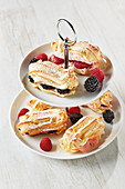 Eclairs with a trio of fruit cream