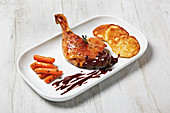 Roast duck leg à l'orange with chocolate sauce and Vichy carrots