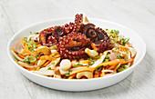 Fried octopus with a papaya salad