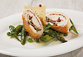 Chicken roulade with green asparagus, peas and mange tout