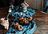 Yummy baked cherry cookies placed on wooden table with piece of cloth and vintage iron
