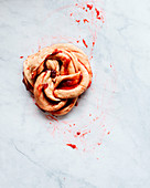 Fresh strawberry brioche on the making placed on a kitchen white modern marble table
