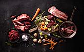 An arrangement of various game meats