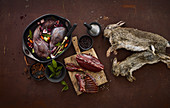 An arrangement of preserved rabbit legs and dead rabbits