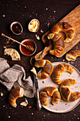 Butter croissants with poppy seeds with butter and honey
