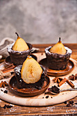 Chocolate muffins with pears inside