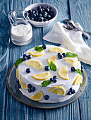 Cream cake with blueberries and lemons