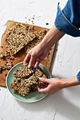 Seeded crackers made from oats, chia seeds, pumpkin seeds and hemp seeds