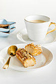 Salted caramel french eclair and coffee