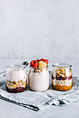 Healthy raspberry parfaits with yogurt in glass jars