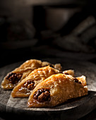 Turkish baklava with walnuts in a dark rustic style